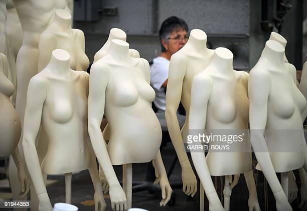A woman works on a mannequin at Patina V in City of Industry California on September 29 2009 Patina V is a company providing mannequins for store...