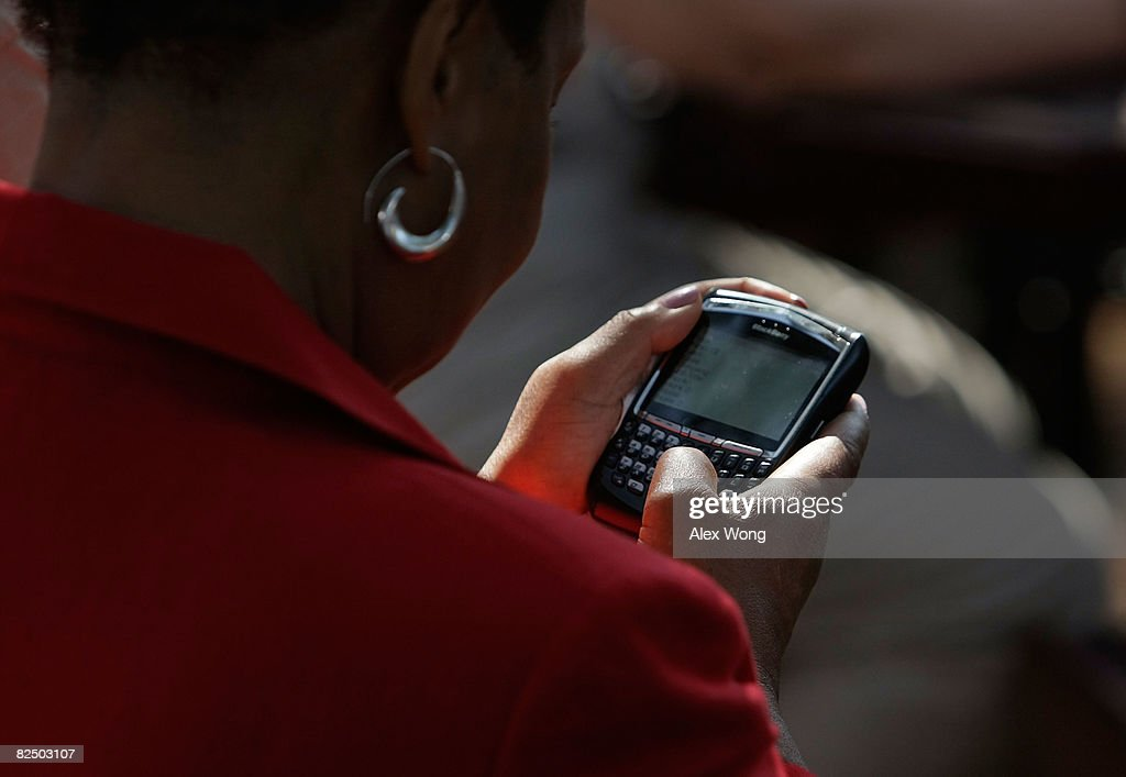 A woman works on her Blackberry phone after she got instructions on how to receive text message about who will be the running mate of Presumptive Democratic Presidential candidate U.S. Sen. Barack Obama (D-IL) during a campaign stop at John Tyler Community College August 21, 2008 in Chester, Virginia. The media have been reported that Obama will announce who is his running mate in Springfield, Illinois on Saturday.