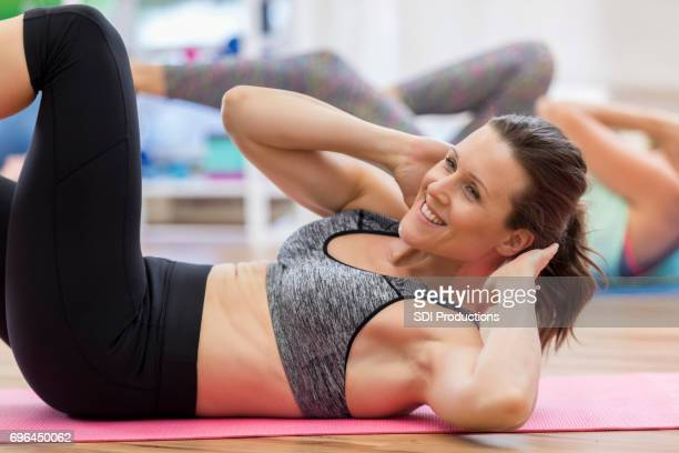 Woman works on stomach crunches at the gym