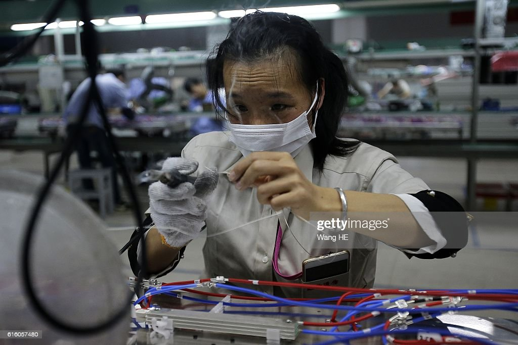 A woman works on the production line at Hongxin