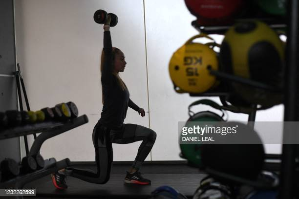 Woman works out at Clissold Leisure Centre in north London as coronavirus restrictions are eased across the country following England's third...