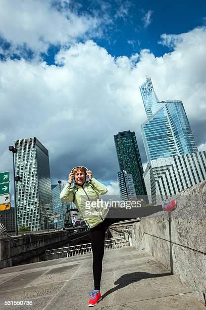 Woman works stretching in La Defense, Paris,France