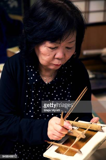 A woman looks for an Omamori a traditional japanese amulet in a Buddhist temple on April 13 2018 in Tokyo Japan
