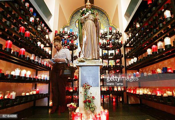 A woman worships prior to Ash Wednesday services at St Jude's Church the day after Mardi Gras festivities February 9 2005 in New Orleans Louisiana...