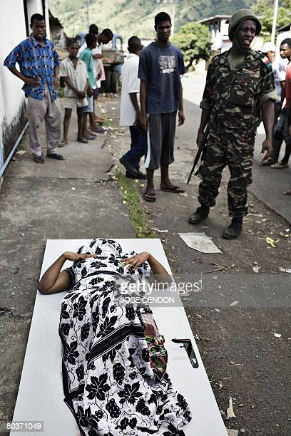 A woman wounded during clashes between supporters of renegade Anjouan leader Mohamed Bacar and a coalition of Comoran and African Union troops lays...