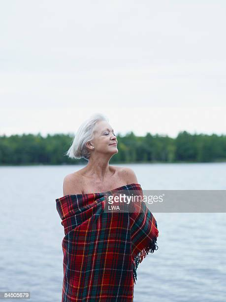 Woman Wrapped in Blanket by Lake