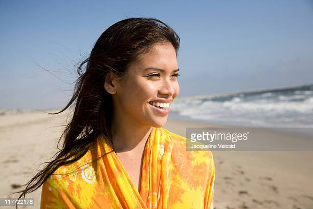 woman wrapped in colorful shawl looking at ocean - beautiful filipino women stock photos and pictures
