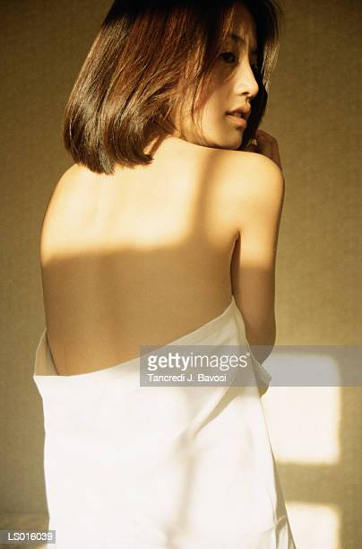 woman wrapped in sheet - bavosi stock photos and pictures
