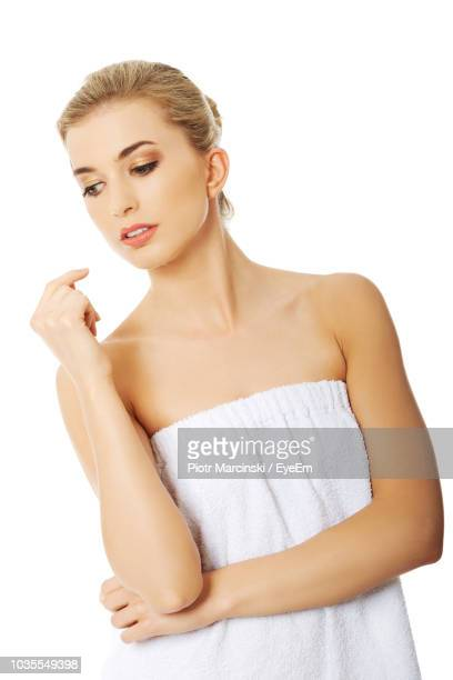 woman wrapped in towel against white background - off shoulder stock pictures, royalty-free photos & images