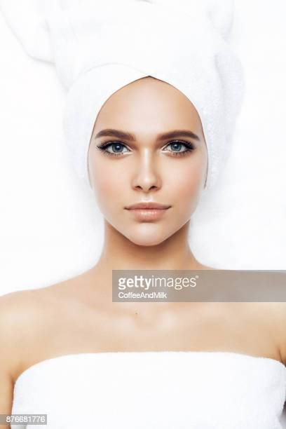 woman wrapped in towel laying down - wearing a towel stock pictures, royalty-free photos & images