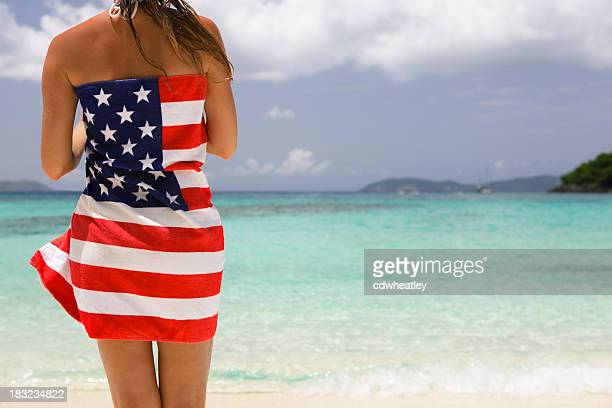 woman wrapped in towel with American flag on it