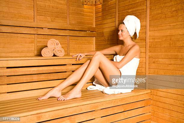 Woman wrapped in towels in sauna