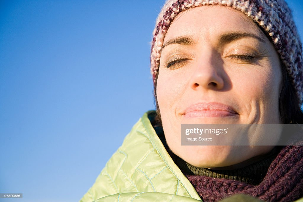 Woman wrapped in warm clothing : Stock Photo