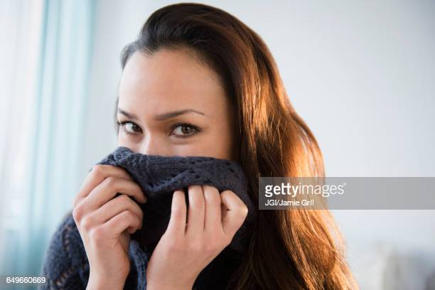 Woman wrapped in warm sweater