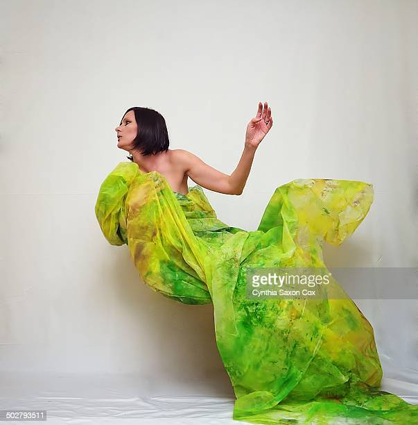 Woman wrapped in yellow green fabric