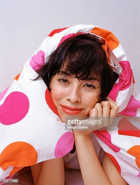 woman wrapped up duvet - women tied to bed stock photos and pictures