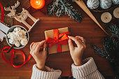 Woman wrapping Christmas gifts, overhead shot