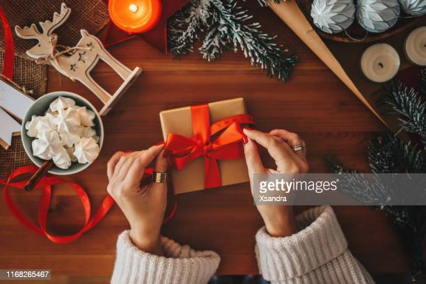 woman wrapping christmas gifts, overhead shot - gift card imagens e fotografias de stock