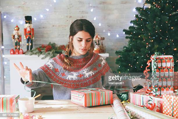 woman wrapping christmas gifts - wrapping paper stock pictures, royalty-free photos & images