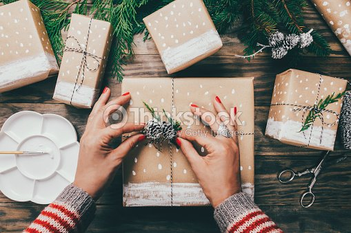 Woman Wring Christmas Presents In A Crafty Way Stock Photo