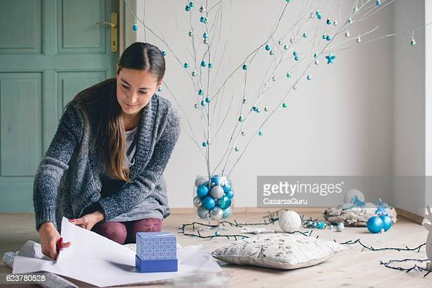 Woman Wrapping Christmas presents
