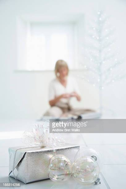 A woman wrapping gifts at christmas