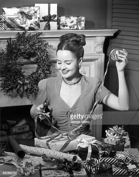 woman wrapping presents - christmas past and christmas present stock pictures, royalty-free photos & images