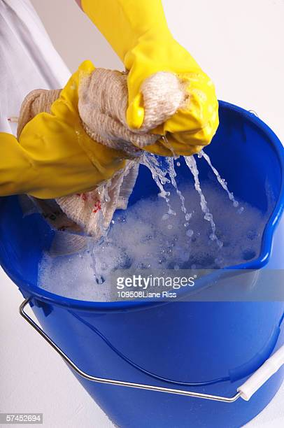 woman wringing out cleaning rag, elevated view - daily bucket stock pictures, royalty-free photos & images