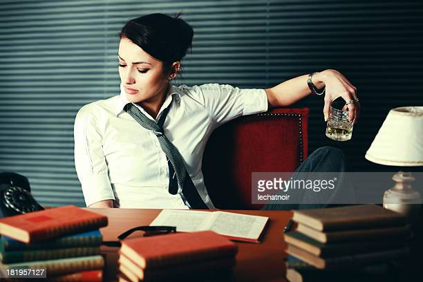 woman writer seeking inspiration - scotch whiskey stock pictures, royalty-free photos & images