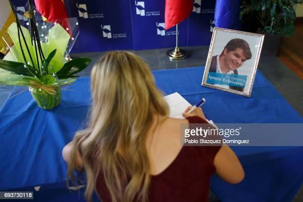 A woman writes in a condolence book next to a picture of Ignacio Echevarria ahead of a vigil to honour London Bridge terror attack hero Ignacio...