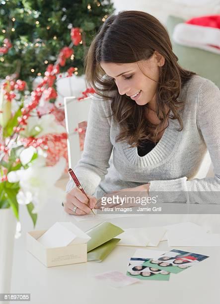 Woman writing at table