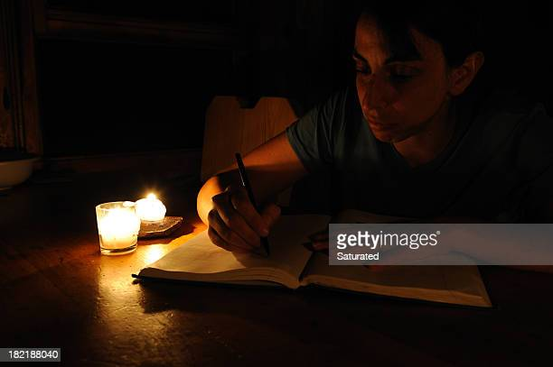 Woman Writing by Candlelight