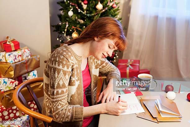 Woman writing christmas cards.