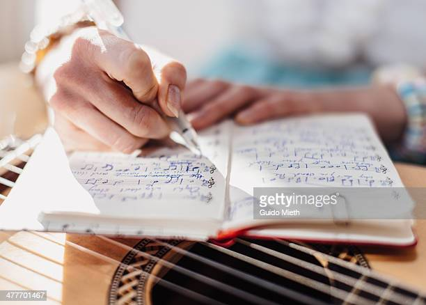 Woman writing down music notes