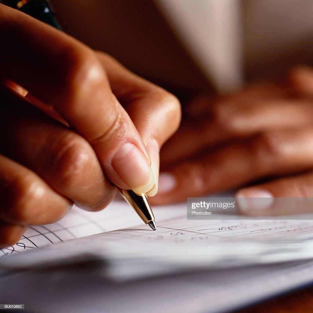 Woman Writing in Checkbook Close-Up : Stock Photo