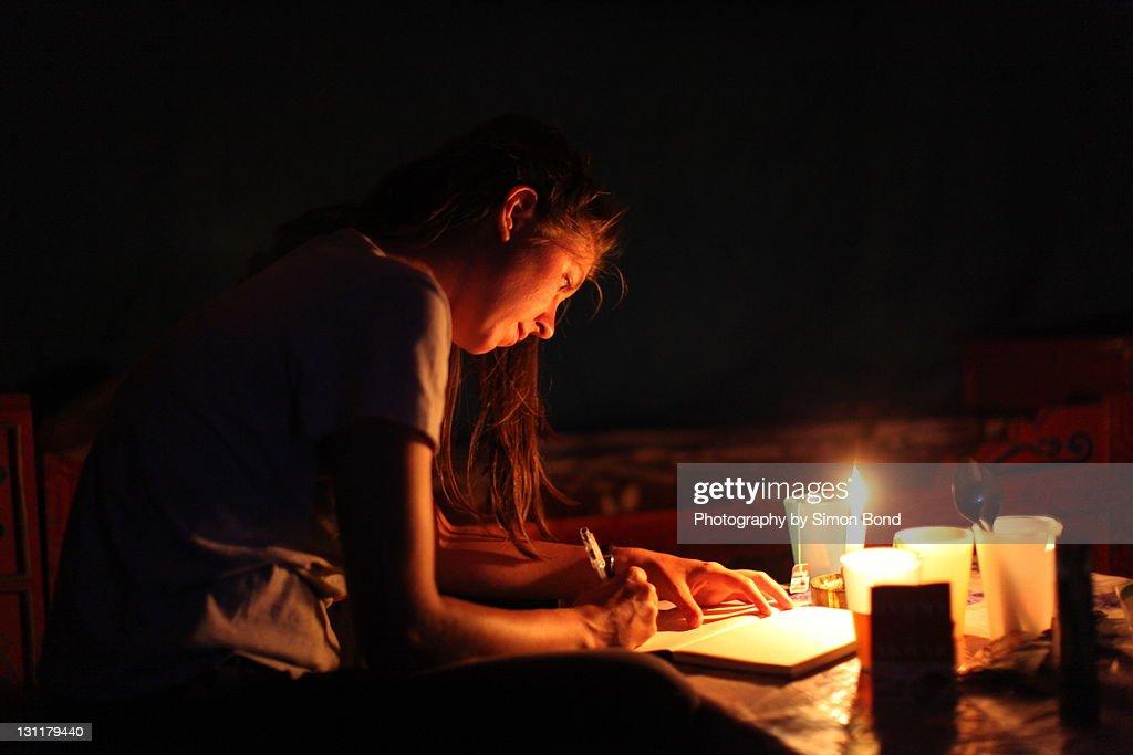 Woman writing in diary : Stock Photo