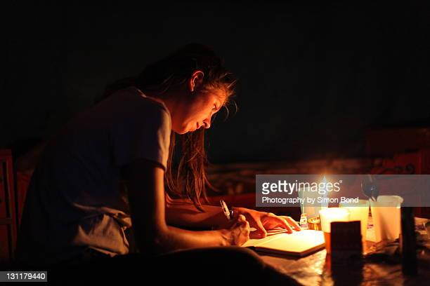 woman writing in diary - mongolian women stock photos and pictures