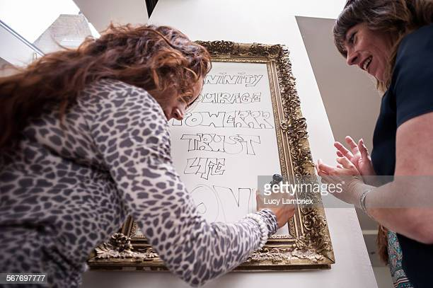 Woman writing inspiring words on a whiteboard