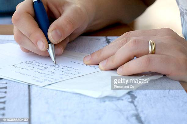 woman writing letter, close-up - correspondence stock pictures, royalty-free photos & images
