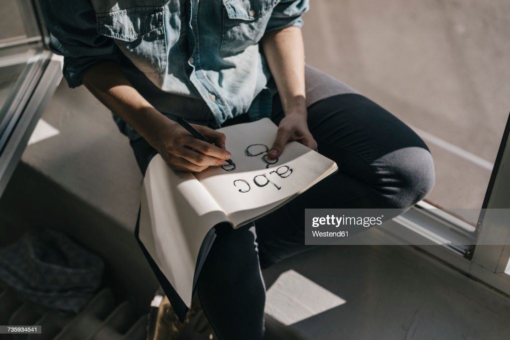 Woman writing letters in folder : Stock Photo