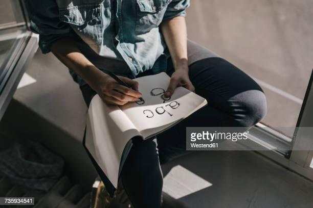 woman writing letters in folder - font stock-fotos und bilder