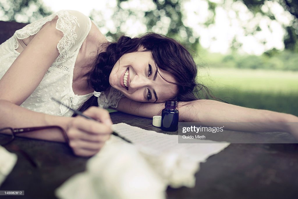 Woman writing love letter with ink : Stock Photo