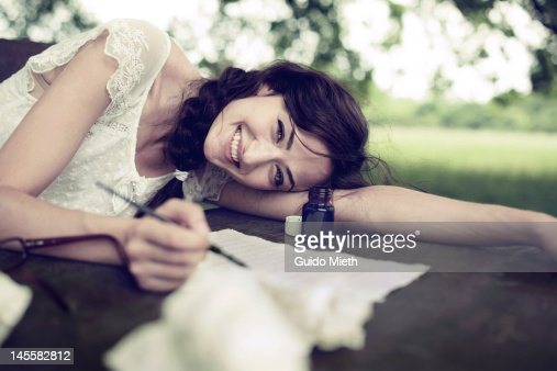 Woman writing love letter with ink stock photo getty images spiritdancerdesigns Image collections