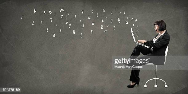 Woman writing on Laptop- Concept - Blogging