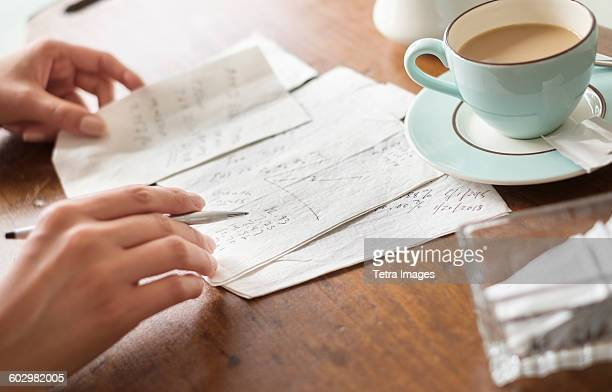 Woman writing on napkins