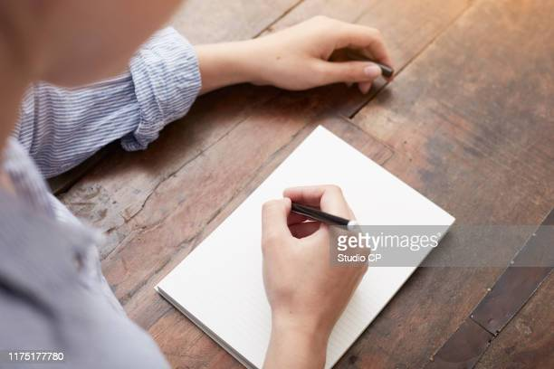 woman writing on notebook - reflection stock pictures, royalty-free photos & images