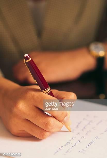 woman writing - responder imagens e fotografias de stock