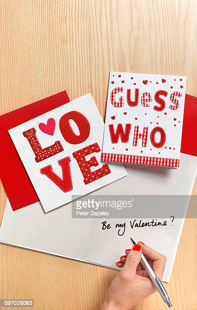 Woman writing valentines card