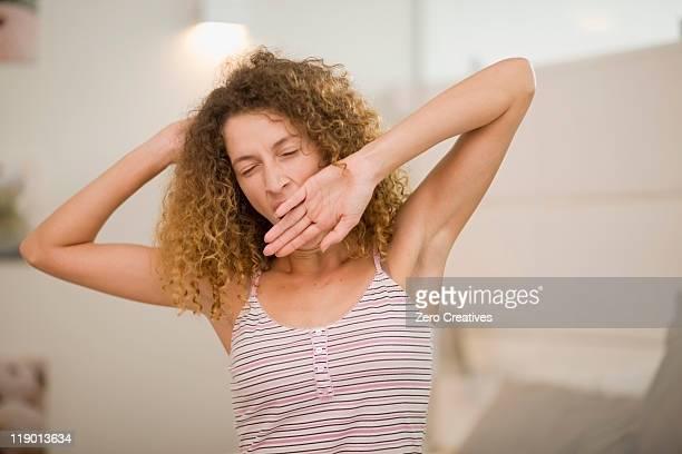 Woman yawning and stretching