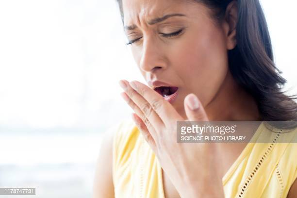woman yawning - mid adult women stock pictures, royalty-free photos & images